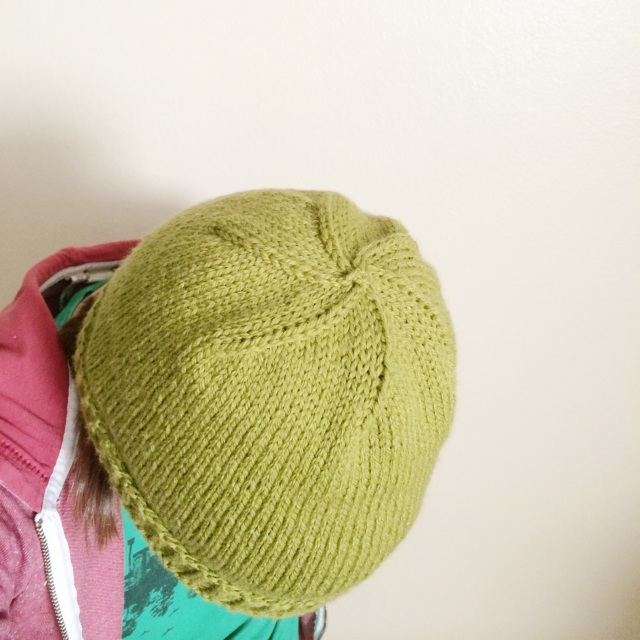 green hat top